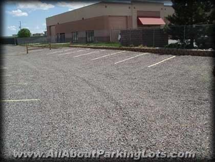 a closeup of a gravel parking lot