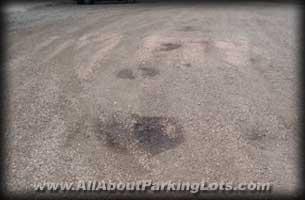 a pothole in a gravel parking lot