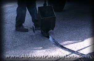 sealing asphalt parking lot cracks with hot pour rubberized sealer