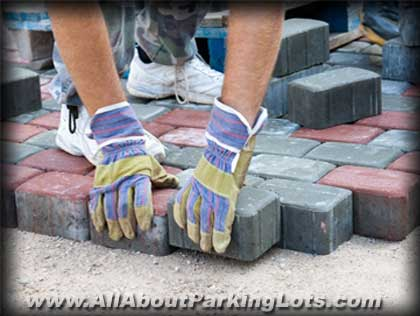 placing pavers for a paver parking lot