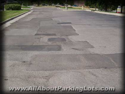 old worn out asphalt parking lot