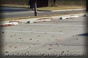 concrete parking lot striping with concrete parking blocks