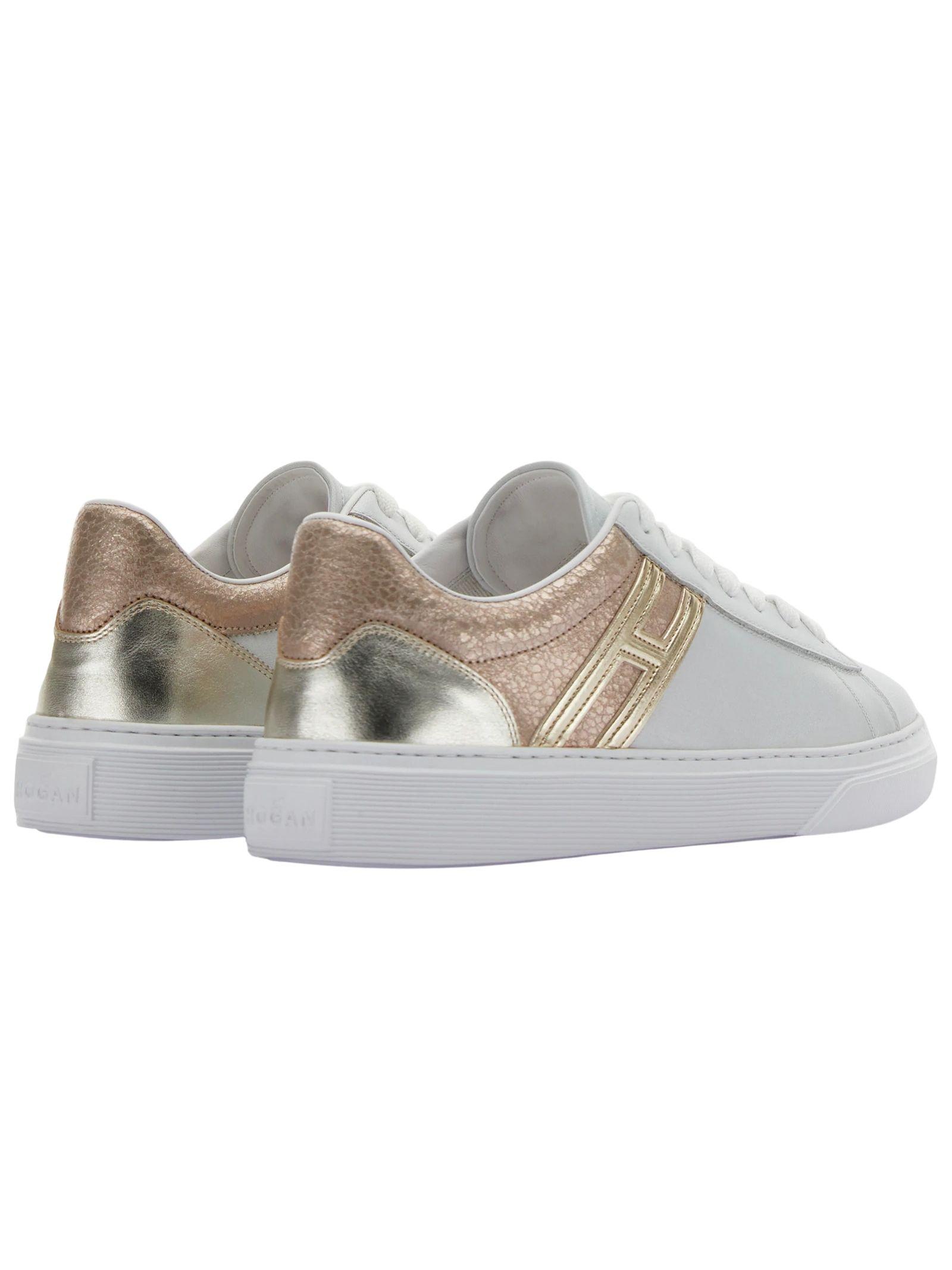 Sneakers in pelle e glitter HOGAN | Scarpe | HXW3650J970P971556