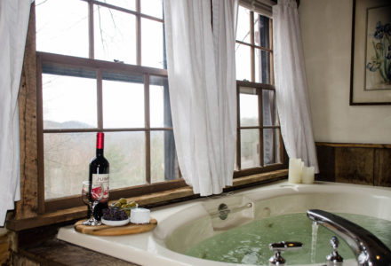 Sugar Tree Country's whirlpool tub with wine and snacks overlooking Shenandoah Valley