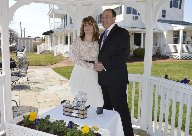 Wedding couple at Inn Harbor Hill under the gazebo