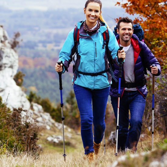 Couple hiking in the fall at a bed and breakfast
