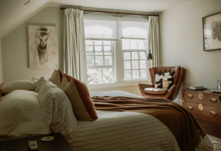 Our king Truro room is complete with a low profile bed and comfortable leather chairs