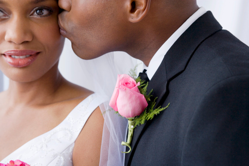 Groom kissing bride, close up, purchase gift certificates online