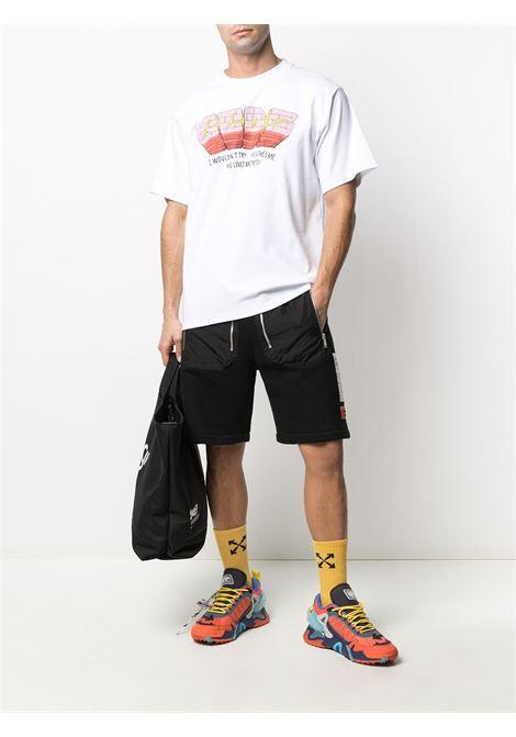 T-SHIRT LOGO WALL GCDS | T-shirt | SS21M020068WHITE
