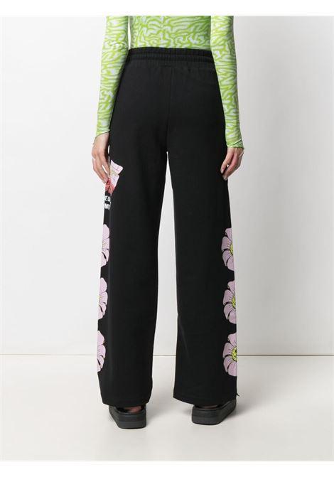 SWEAT PANT STAMPA FIORI GCDS | Pantalone | SS21W030042BLACK