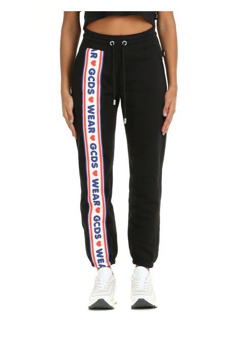 SWEATPANTS IN BLACK COTTON GCDS | Tracksuit pants | CC94W03145602