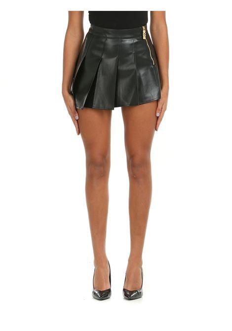 ASYMMETRIC MINI SKIRT IN LEATHERETTE GCDS | Skirts | FW22W03001002
