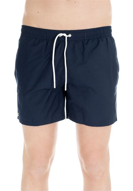 BLUE NAVY SWIM SHORTS WITH EMBROIDERY LOGO Lacoste | Swimsuits | MH70929NX