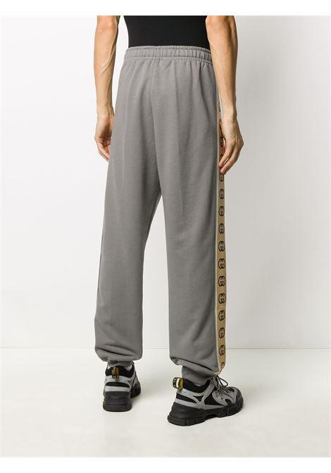 Pantalone grigio GUCCI | PANTALONI | 630713XJBUW1233