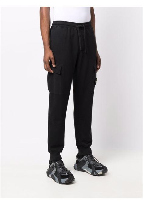Black track pants STONE ISLAND | 751565220V0029