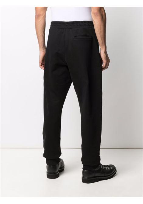 Black/white track pants VERSACE | TROUSERS | 10010851A007201B000