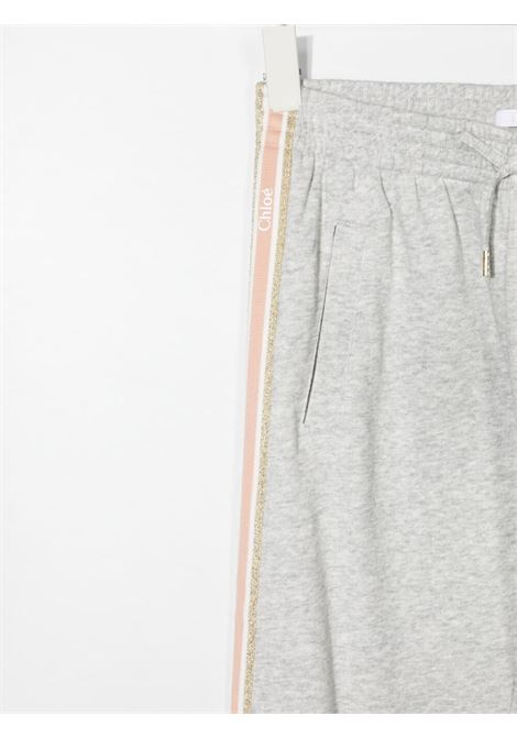 Grey track pants CHLOE KIDS | TROUSERS | C14665TA32