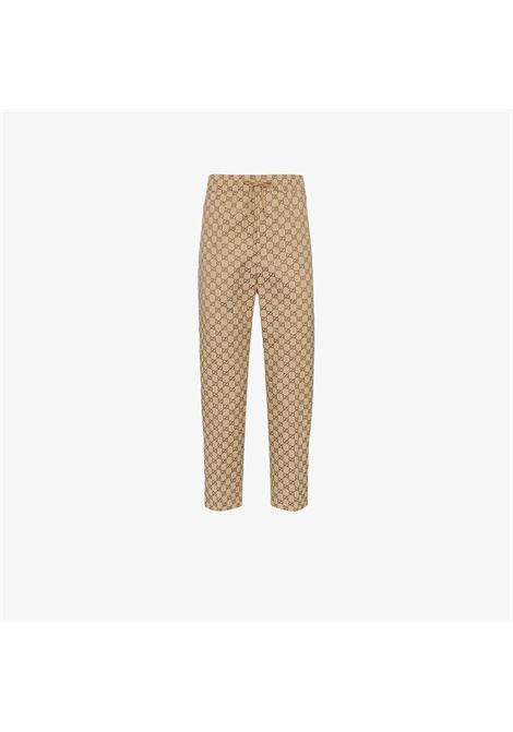 Pantalone beige GUCCI | PANTALONI | 569769ZKU092580