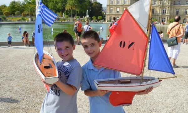 Kids With Sailboats in Luxembourg Gardens in Paris