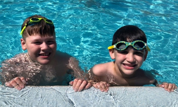 Two boys in the pool at the Island Hotel, in Fort Walton Beach, Florida. Photo by Lindsay Flagan