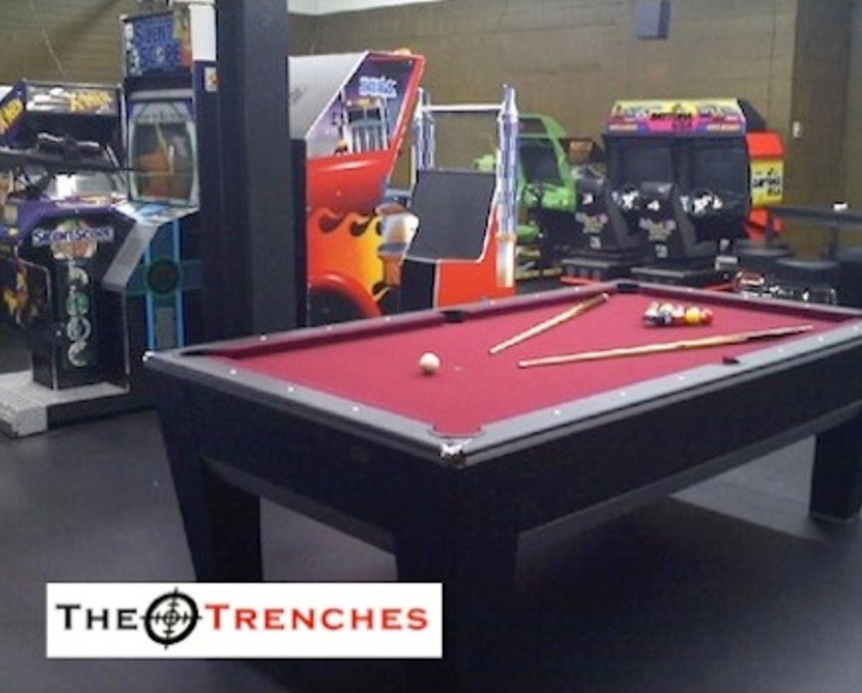 $149 for Private Birthday Party, Unlimited Games & Pizza for 15 Guest (61% off) OR $10 for Admission with Unlimited Games at The TRENCHES Multimedia Game Lounge and Arcade in Rockville (50% Off)