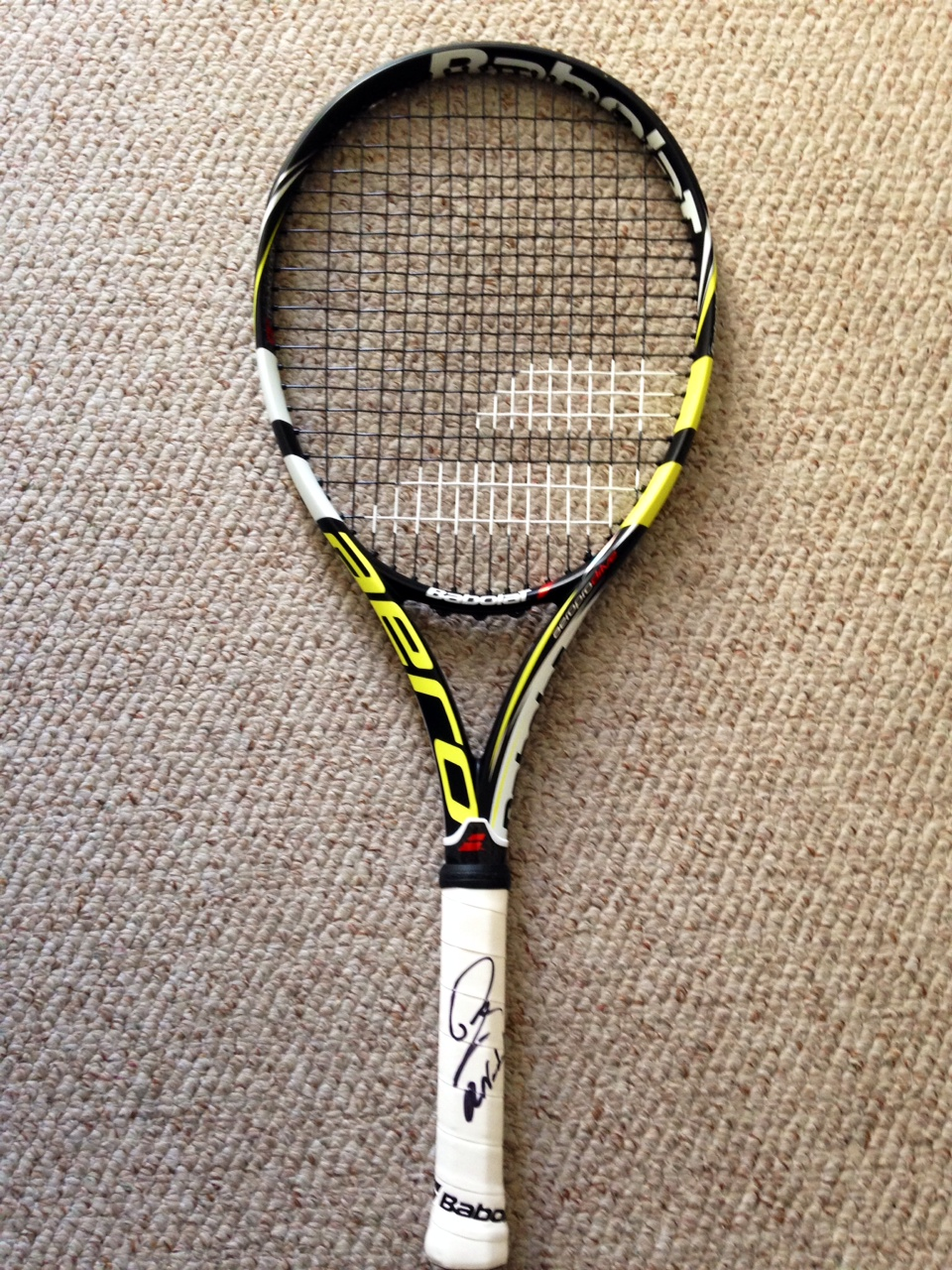 Charitybuzz: Take Home a Tennis Racket Signed by Rafael ...