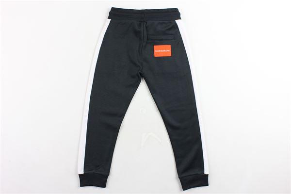 pantalone tuta felpato tinta unita profili in contrasto CALVIN KLEIN | Pantaloni | IB0IB00056NERO