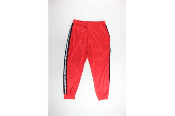 pantalone tuta triacetato tinta unita profili in contrasto PARENTAL ADVISORY | Pantaloni | AD933UROSSO