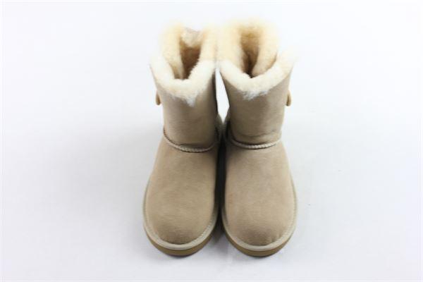 stivali alti tinta unita imbottiti in pelliccia sintetica con bottone laterale UGG | Scarpe | 5991K/SANBEIGE