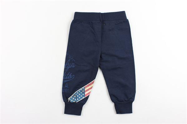 pantalone in felpa tinta unita con stampa FRED MELLO | Pantaloni | 014442BLU