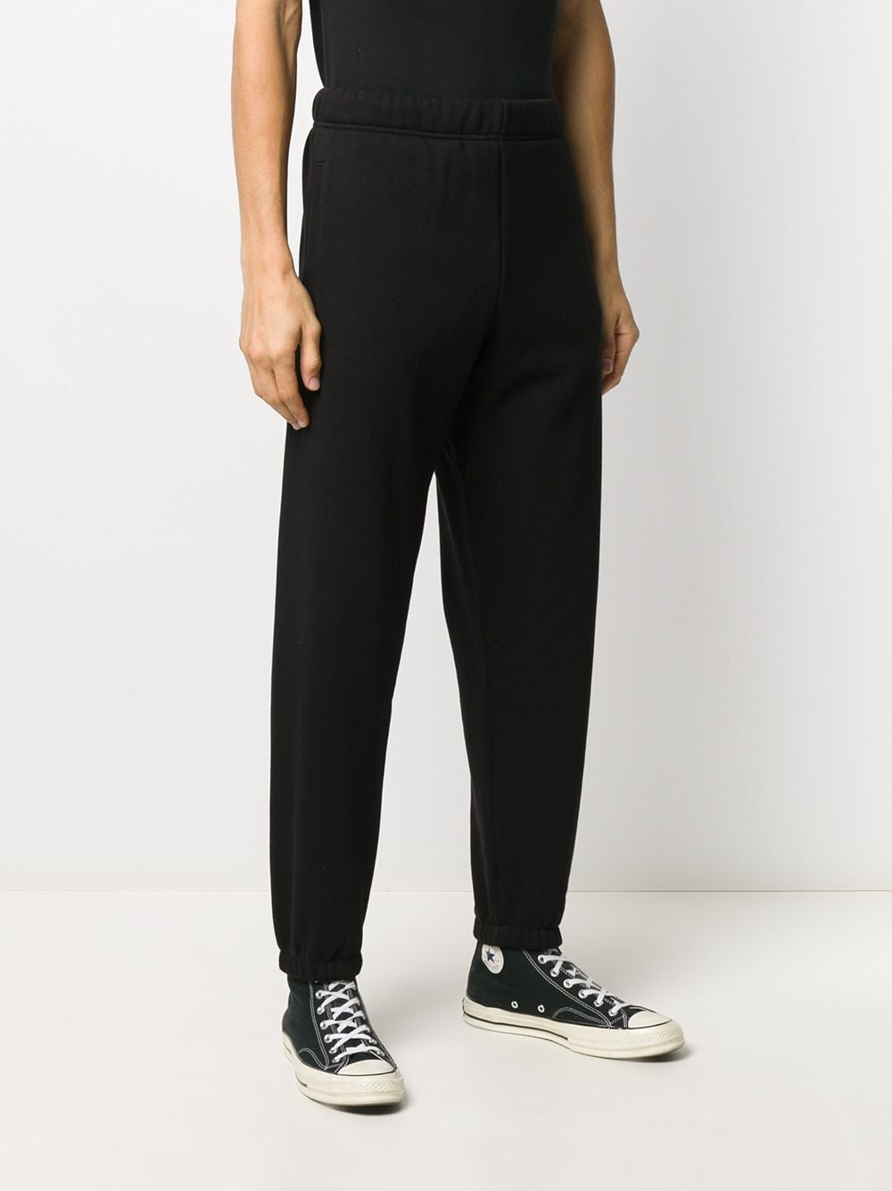 sweatpants man black in cotton CARHARTT WIP | Trousers | I02828400F.XX