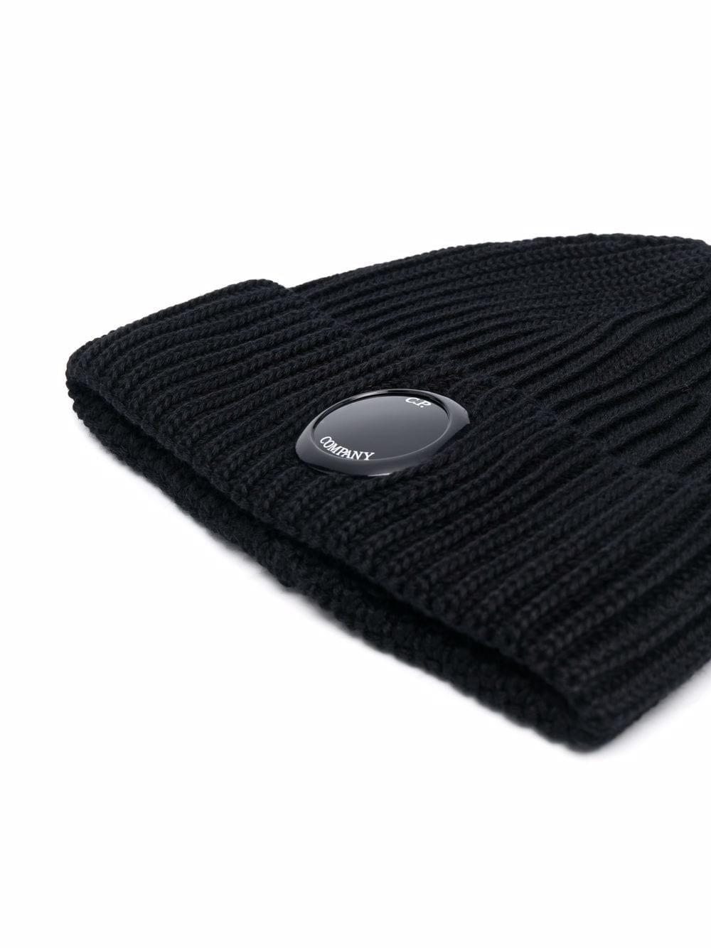 cappello con applicazione uomo nero in lana C.P. COMPANY | Cappelli | 11CMAC272A005509A999