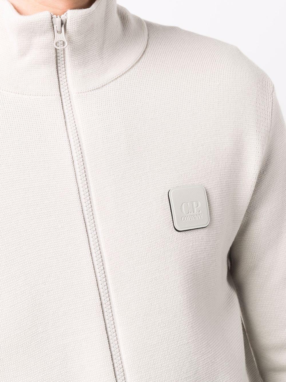 cardigan con logo uomo bianco in lana C.P. COMPANY | Maglieria | 11CMKN124A005292A116