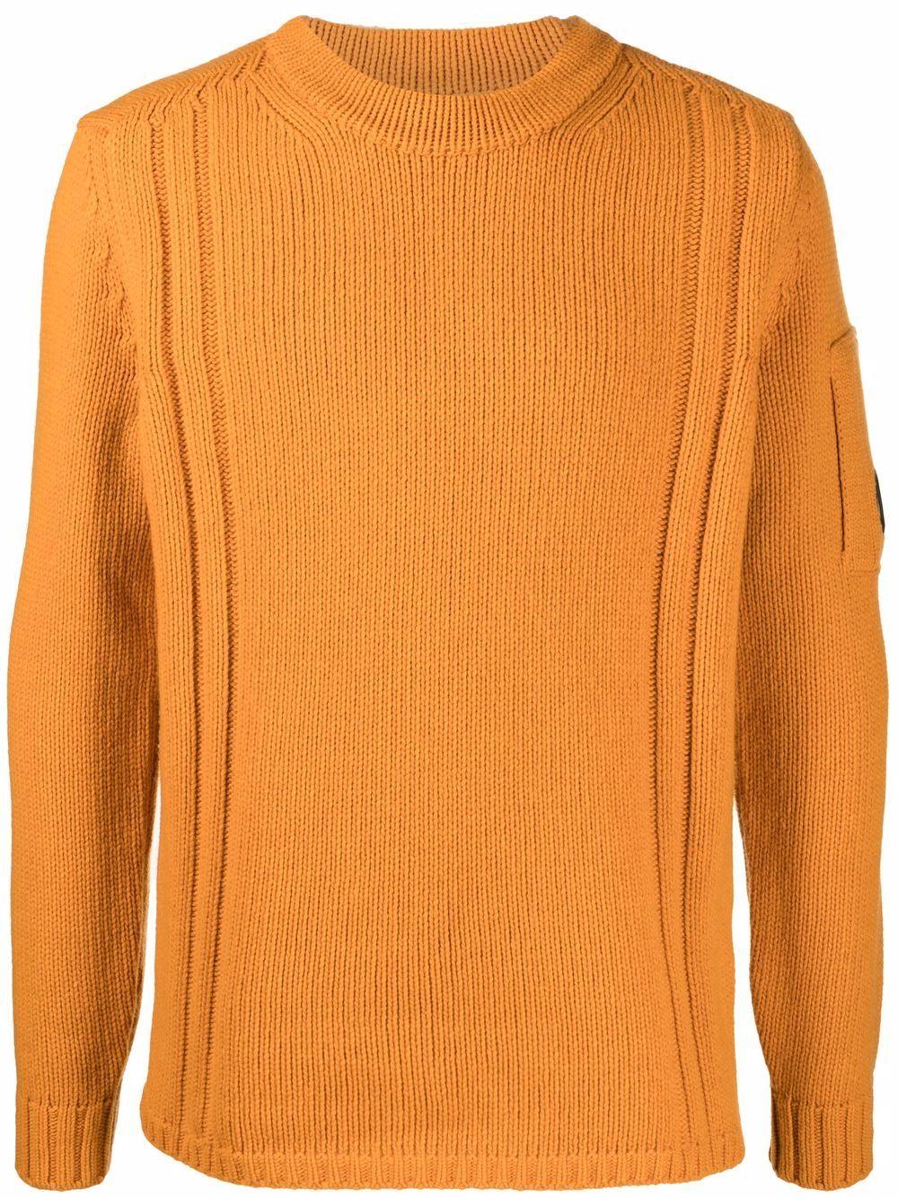 maglione a girocollo uomo arancione in lana C.P. COMPANY   Maglieria   11CMKN142A005504A436