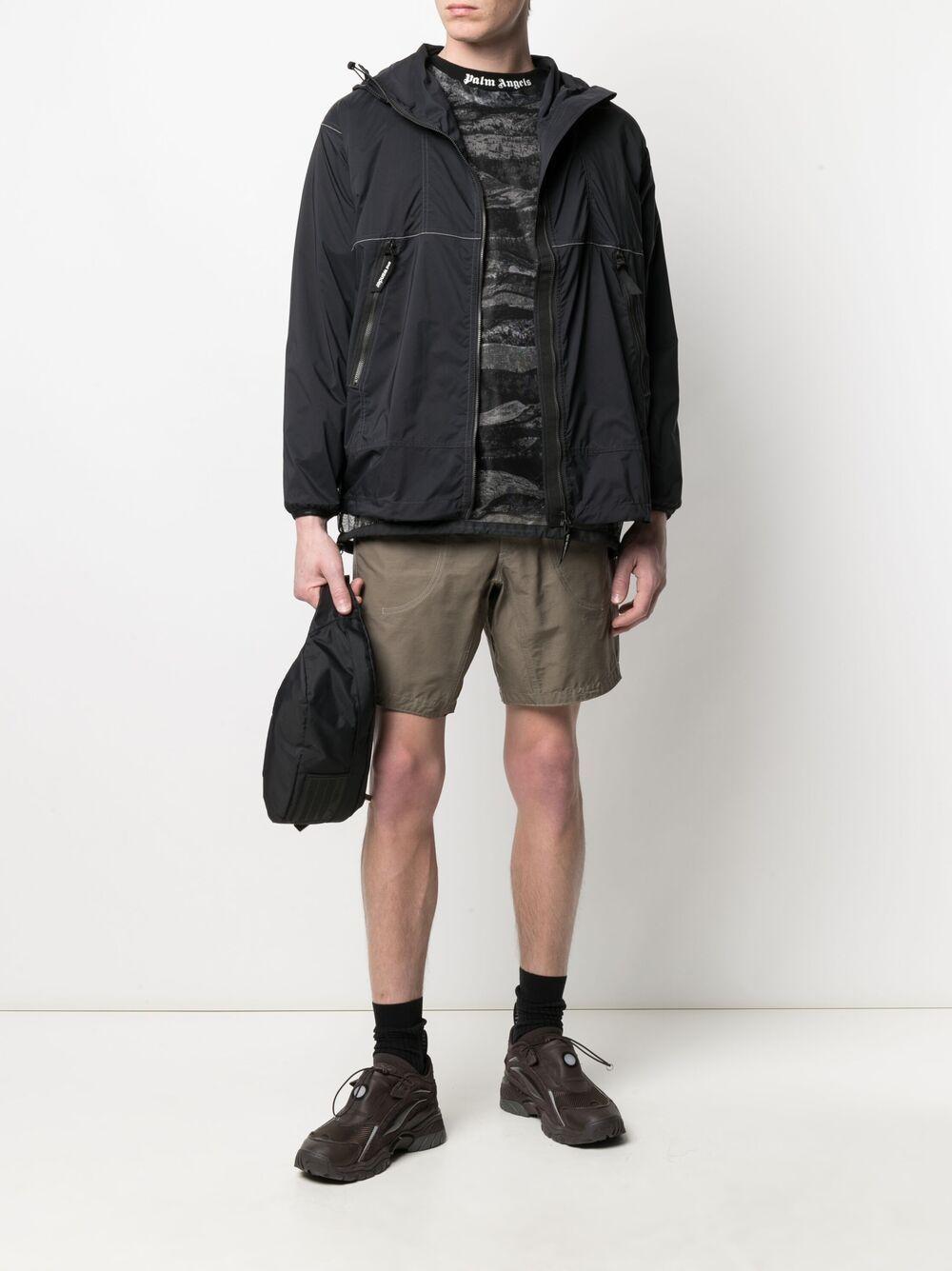 And Wander giacca leggera con stampa logo uomo nero AND WANDER | Giacche | 5740921034010