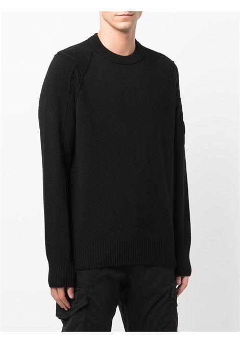 maglione in lana uomo nero C.P. COMPANY | Maglieria | 11CMKN087A005504A999