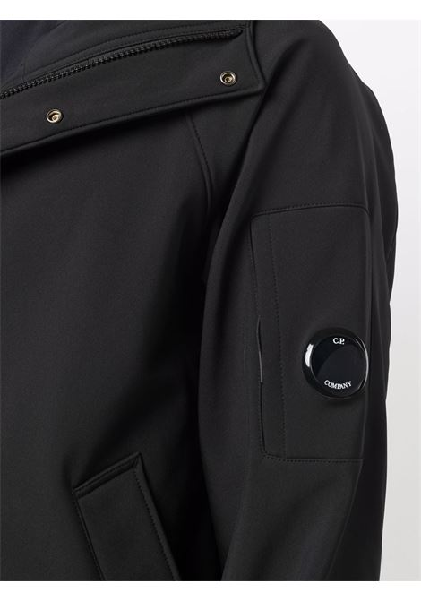 giacca lunga uomo nera in poliestere C.P. COMPANY | Giacche | 11CMOW105A006097A999