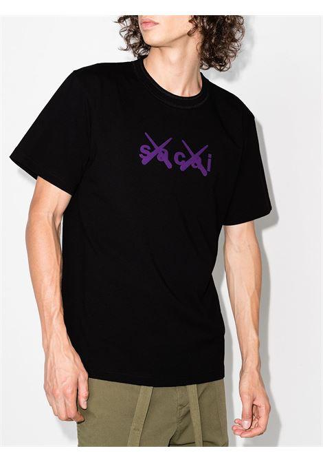 kaws t-shirt man black in cotton KAWS X SACAI | T-shirts | 21-0288S024