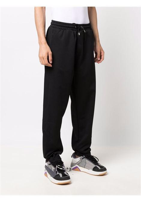 sports pants man black KENZO   Trousers   FB65PA7514IP99