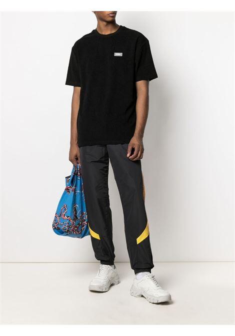 032c t-shirt con patch logo uomo nero 032c | T-shirt | SS21-C-1010BLACK