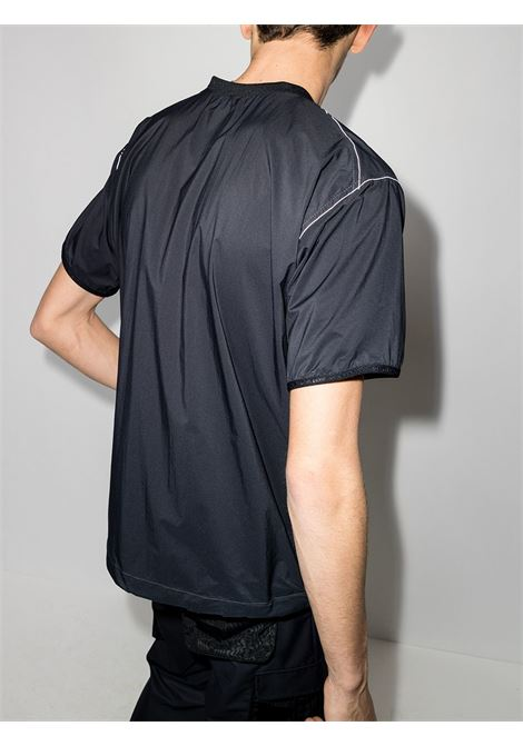 And Wander t-shirt pertex wind uomo nero AND WANDER | Camicie | 5740921036010