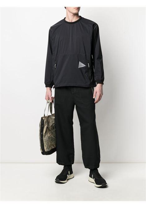 And Wander pantaloni con cintura uomo nero AND WANDER | Pantaloni | 5741142054010