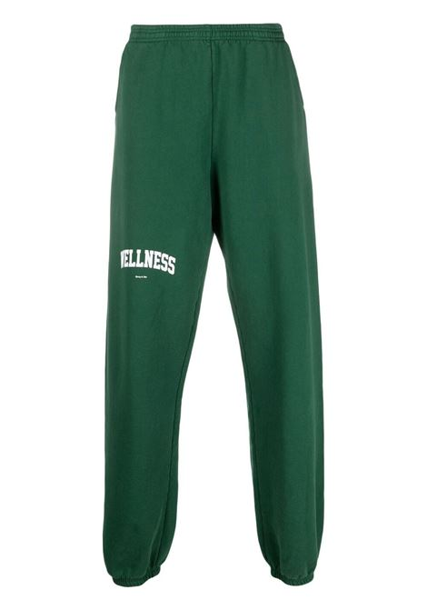 Sporty & Rich logo print track pants unisex green SPORTY & RICH | Trousers | SW091BR