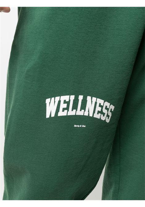 Sporty & Rich logo print track pants unisex green SPORTY & RICH | Trousers | SW091BR