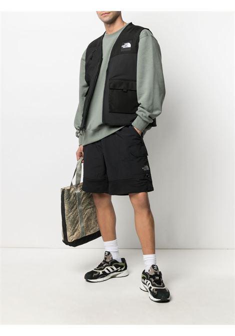 The North Face logo sleeveless jacket man black THE NORTH FACE | Jackets | NF0A557FJK31