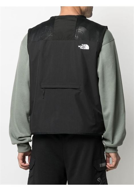 The North Face logo sleeveless jacket man black THE NORTH FACE | Jackets | NF0A557FJK31