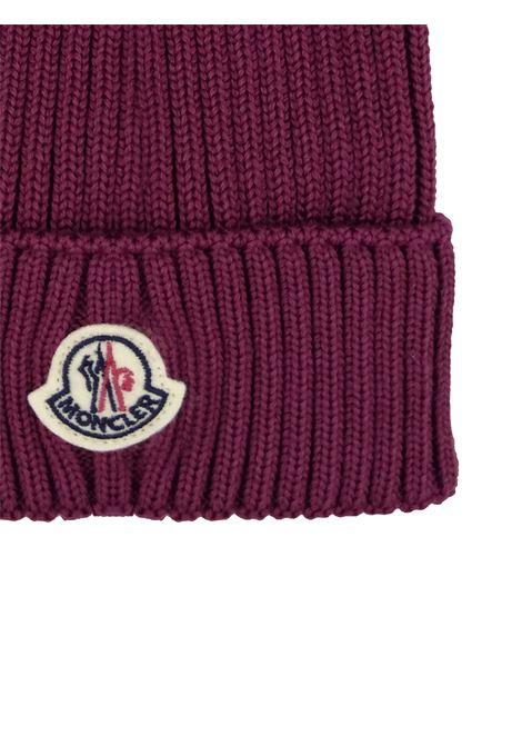 cappello moncler con pon pon e logo MONCLER | Cappello | F29543B7111004S01485