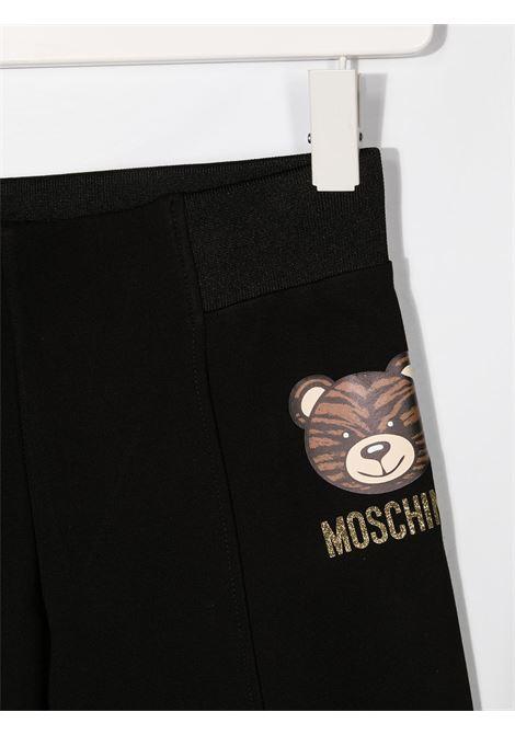 leggins Moschino  con orsetto tigrato e scritta logo oro MOSCHINO KIDS | Leggins | HDP03TLJA0260100T