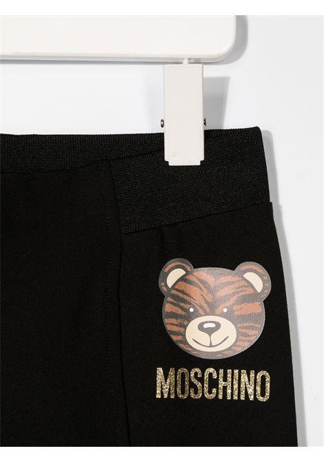 leggins Moschino  con orsetto tigrato e scritta logo oro MOSCHINO KIDS | Leggins | HDP03TLJA0260100