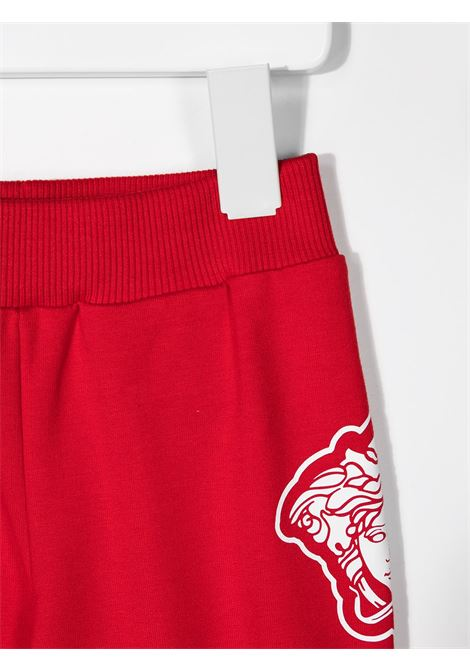pantalone in felpa con stampa logo laterale young versace young versace | Pantalone | YB000169YA00077A1227
